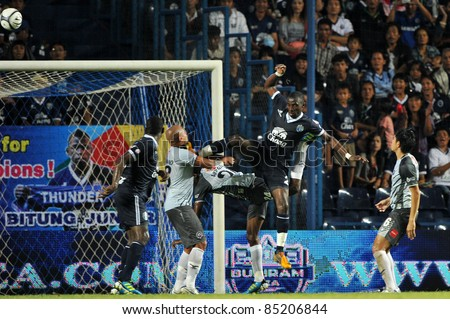 BURIRAM, THAILAND-SEPT. 21:Obama Joseph Florent of Buriram PEA in action during Toyota League Cup between Buriram PEA(B) and Chonburi Fc(G) at I-mobile Stadium on September 21, 2011 in Buriram Thailand