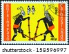 "BURKINA FASO - CIRCA 1985: A stamp printed in Burkina Faso from the ""Dodo Carnival"" issue shows two dancers and two drummers, circa 1985.  - stock photo"