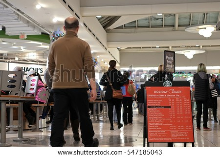 Burnaby, BC, Canada - December 06, 2016 : One side of people having dinner at food court area inside Burnaby shopping mall