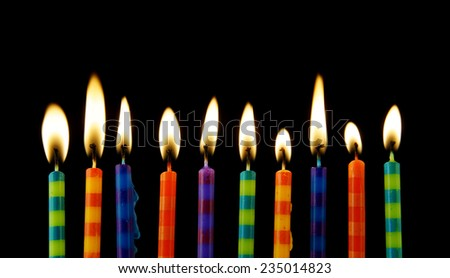 Burning candles on black background