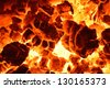 Burning coal. Close up of red hot coals glowed in the stove. - stock photo