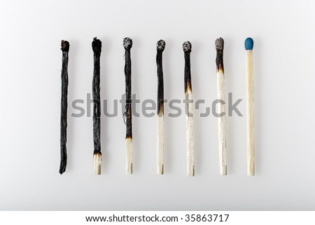 Burnt Matches in a row symbolizing economic recovery
