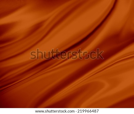 burnt orange color background abstract cloth or liquid wave of wavy folds of silk texture