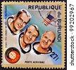 BURUNDI - CIRCA 1975: A stamp printed in Burundi shows American astronauts Jack R. Lousma, Ronald Evans and Alan Bean, circa 1975 - stock photo
