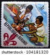 BURUNDI - CIRCA 1967: A stamp printed in Burundi shows Scouts preparing meal, circa 1967 - stock photo