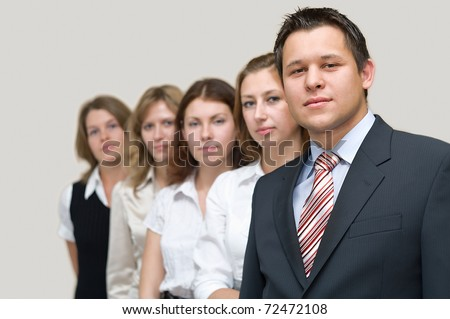 Business a team of five people with the man the leader at the head. On a white background. One man and four woman