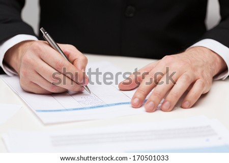 business and office concept - close up of businessman with papers
