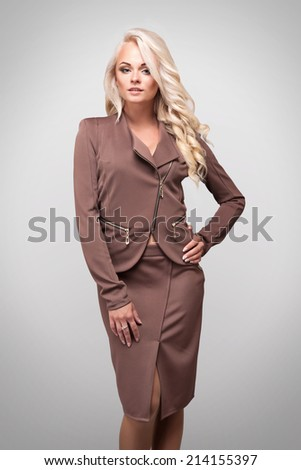 Business beautiful girl in a business suit