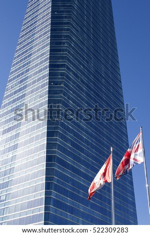 Business building with Uk and Canada flags