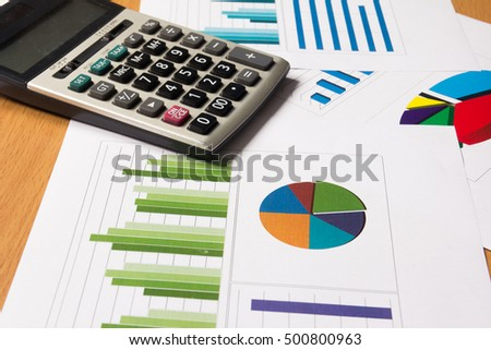 Business chart and graph with calculator