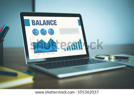 Business Charts Graphs on screen with BALANCE Concept