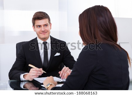Business colleagues discussing over document in meeting