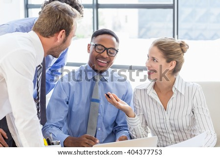Business colleagues interacting with each other in meeting at office