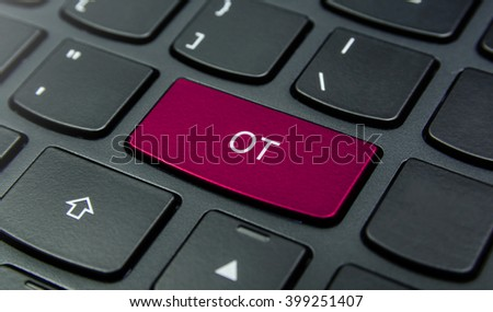 Business Concept: Close-up the OT button on the keyboard and have Magenta color button isolate black keyboard