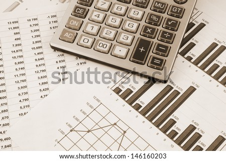 Business concept with calculator and documents