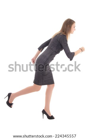 business concept - woman in dress running isolated on white background