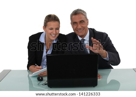 Business couple laughing