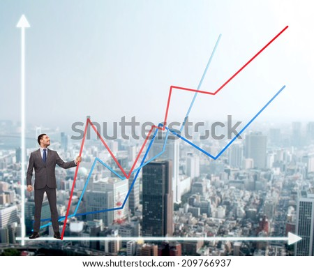 business, development and people concept - smiling man holding graph line over chart and cityscape background