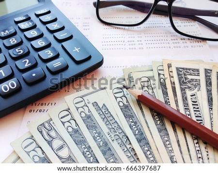Business, Finance, Savings, Banking Or Loan Concept : Pencil, Calculator,  Eyeglasses