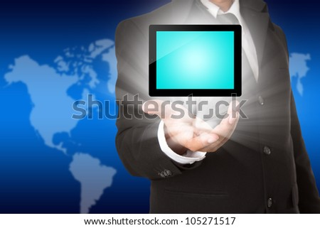 business hand holding a tablet touch screen computer