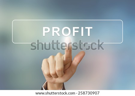 business hand pushing profit button on blurred background