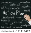 business hand writing action plan concept - stock photo