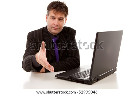 business man at work is shaking your hand, over white background