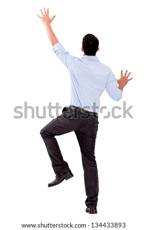 Business man climbing a wall - isolated over a white background