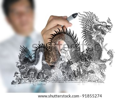 Business man draw chinese dragon