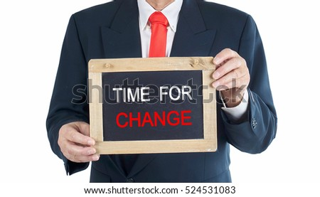 Business man Holding a chalkboard with words: time for change
