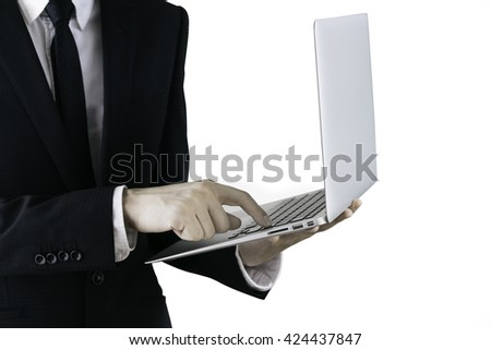 Business man holding a laptop pressing keyboard