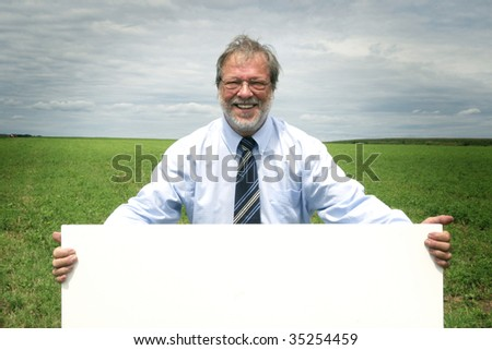 Business man holding blank board