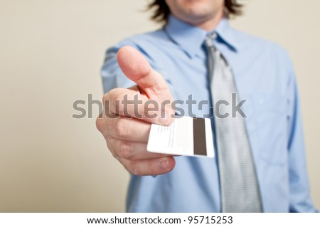 Business man holding credit card. Shopping and spending concept