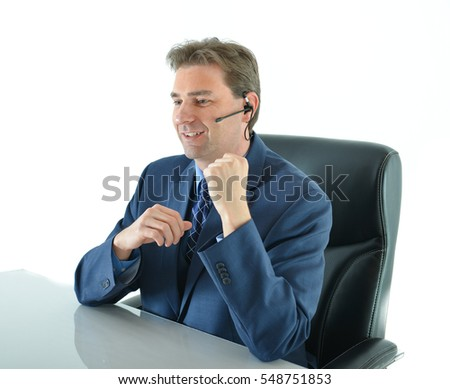 Business man on phone or customer service representative helping customers at his desk