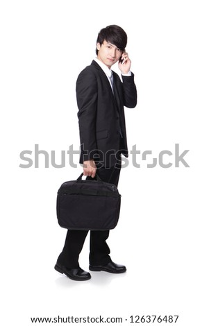 Business man Walking while talking on the mobile phone in full length isolated over white background, asian model
