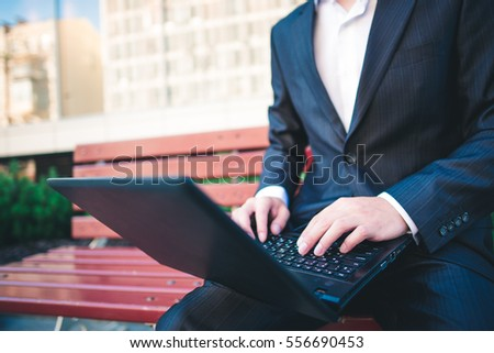 Business man with laptop, notebook. Businessman with computer. Internet wireless technology. Professional communication in office. Modern male person in work. Adult succes people.