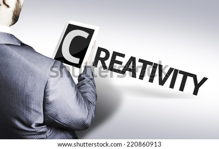 Business man with the text Creativity in a concept image