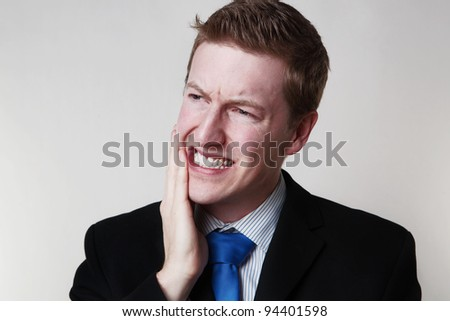 business man with toothache looks like hes in pain and need to go to the dentist