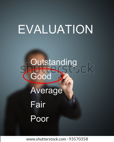 business man write red mark at good choice on evaluation survey form