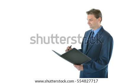 Business man writing in portfolio