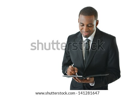 Business man writing notes in his portfolio
