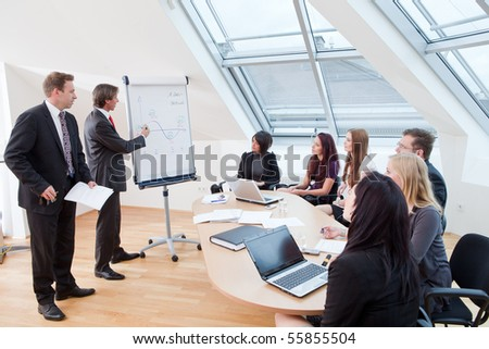 business meeting with seven people at the conference room