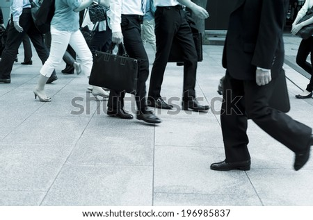 Business men walking on the pavement
