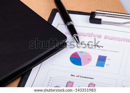 Business paperwork present with diagram