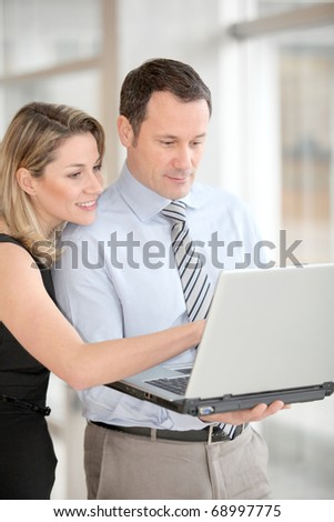 Business partners working on laptop computer