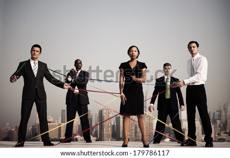 Business People Connected by Strings by New York City Skyline