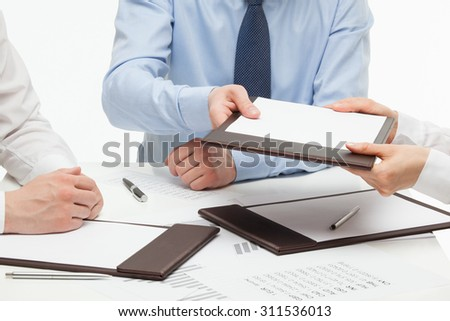 Business people holding documents, closeup shot