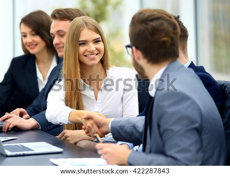 business people in formalwear sitting at the table