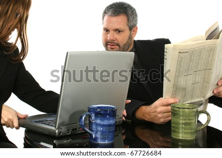 Business people looking at laptop while on break.