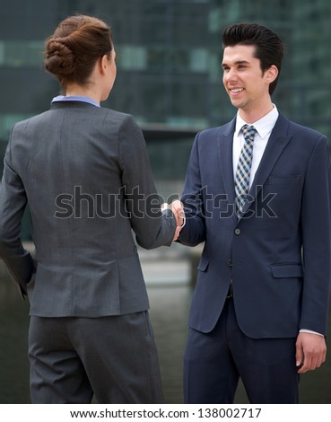 Business people meeting and greeting with a handshake outdoors